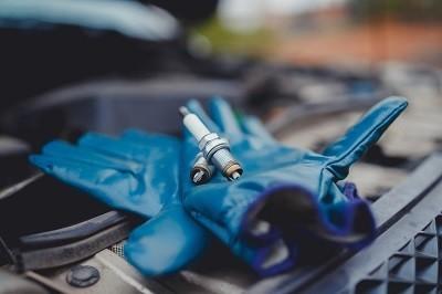 Spark plugs lie on gloves